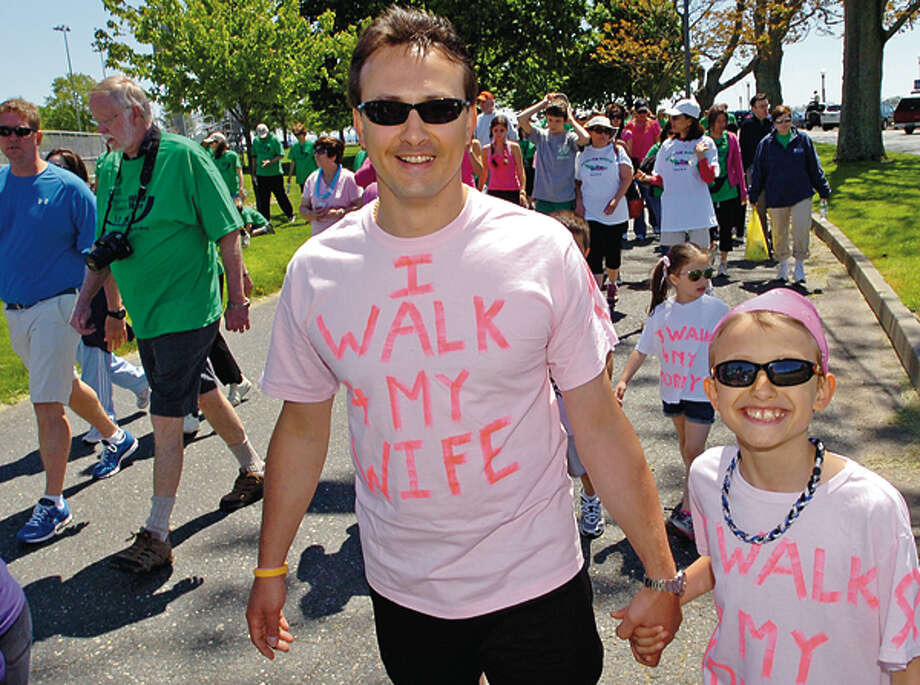Leo Catterino and his son, Luigi, participate in the Norwalk Hospital Whittingham Walk & Sally's Run at Calf Pasture Beach Saturday. Hour photo / Erik Trautmann / (C)2011, The Hour Newspapers, all rights reserved