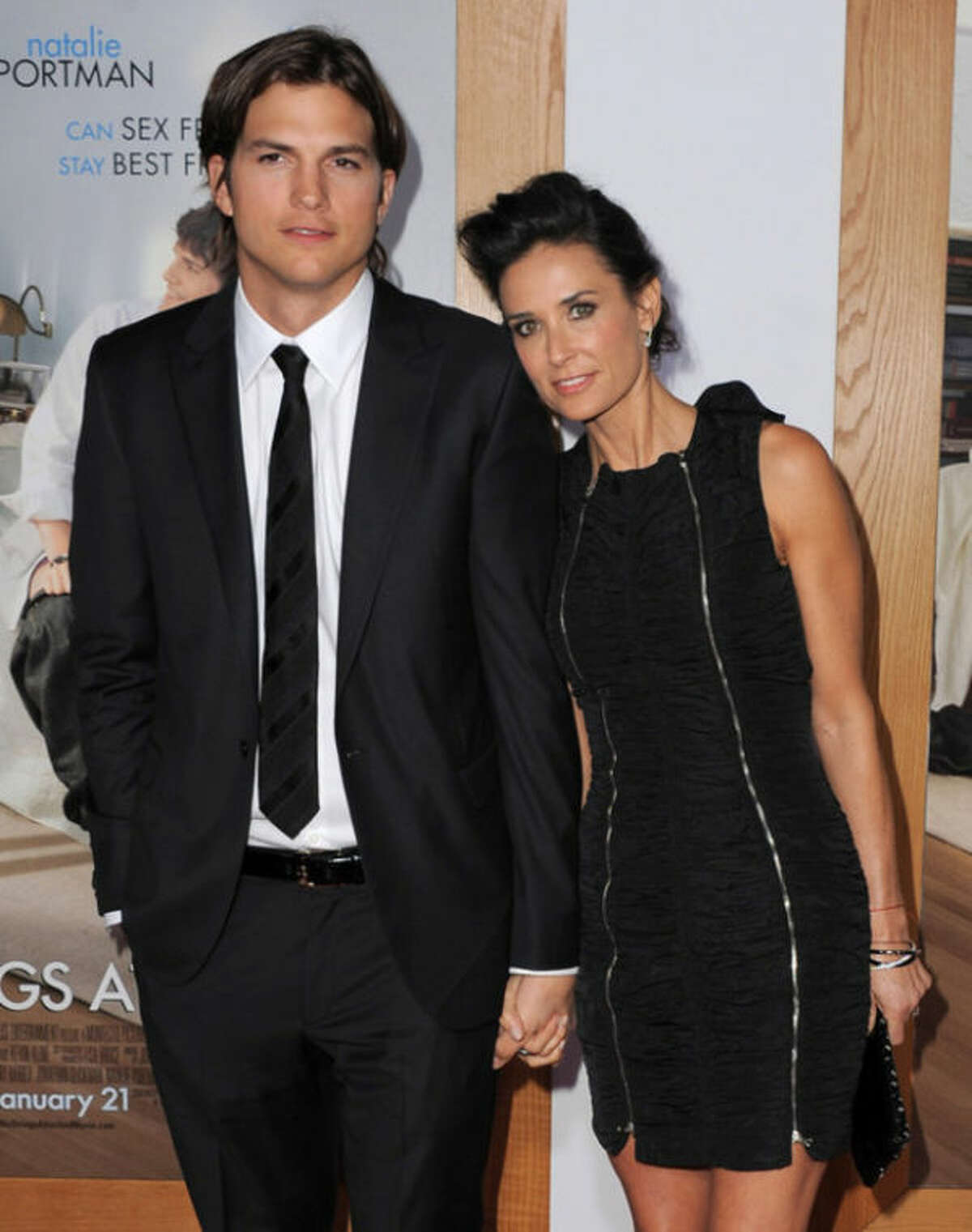 """FILE - In this Jan. 11, 2011 file photo, actor Ashton Kutcher, left, and actress Demi Moore arrive at the """"No Strings Attached"""" Los Angeles Premiere at Regency Village Theatre in Westwood, Calif. Moore is seeking spousal support from Kutcher, according to divorce paperwork filed Thursday March 7, 2013, in Los Angeles. The couple split in 2011 after more than six years of marriage. (Photo by Jordan Strauss/Invision/AP Images, File)"""