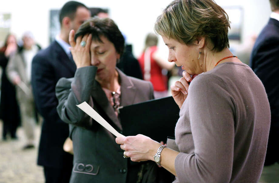 In this Monday, Feb. 25, 2013. Ann Oganesian, left, of Newton, Mass., pauses as she speaks with a State Dept. employee about job opportunities with the federal government during a job fair in Boston. The Labor Department is scheduled to release the jobs report at 8:30 a.m. EST Friday March 8, 2013. (AP Photo/Michael Dwyer) / AP