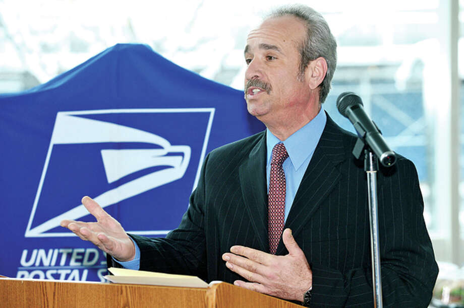 Post Office Operations Manager of the USPS, Guy Polacco, makes remarks as Jeffrey Salamon is sworn in as Stamford's new Postmaster during a ceremony at the Stamford Government Center Friday. Hour photo / Erik Trautmann / (C)2013, The Hour Newspapers, all rights reserved