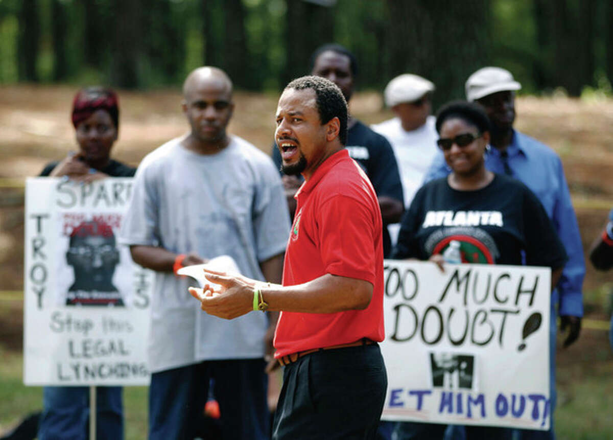 AP Photo / John Bazemore A man preaches during a rally for Georgia death row inmate Troy Davis In Jackson, Ga., Wednesday. Davis was set to die Wednesday night for killing off-duty Savannah officer Mark MacPhail.