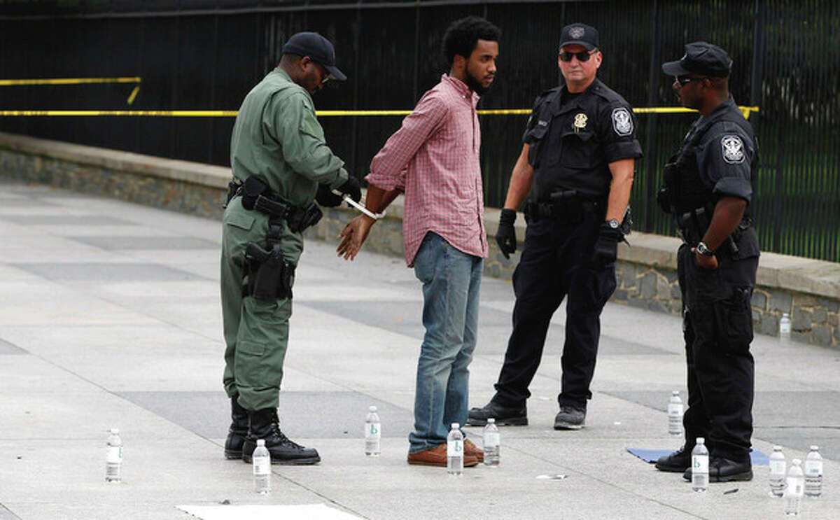 AP Photo / Charles Dharapak A demonstrator is arrested by U.S. Park Police officers in front of the White House in Washington, D.C., Wednesday, protesting the planned execution of death row inmate Troy Davis.