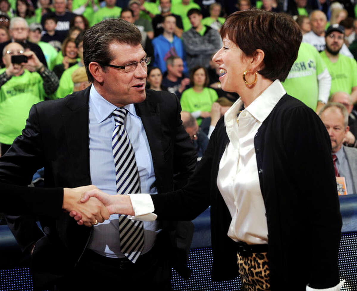 Connecticut head coach Geno Auriemma, left, shakes hands with Notre Dame head coach Muffet McGraw before an NCAA college basketball game, Monday, March 4, 2013, in South Bend, Ind. (AP Photo/Joe Raymond)