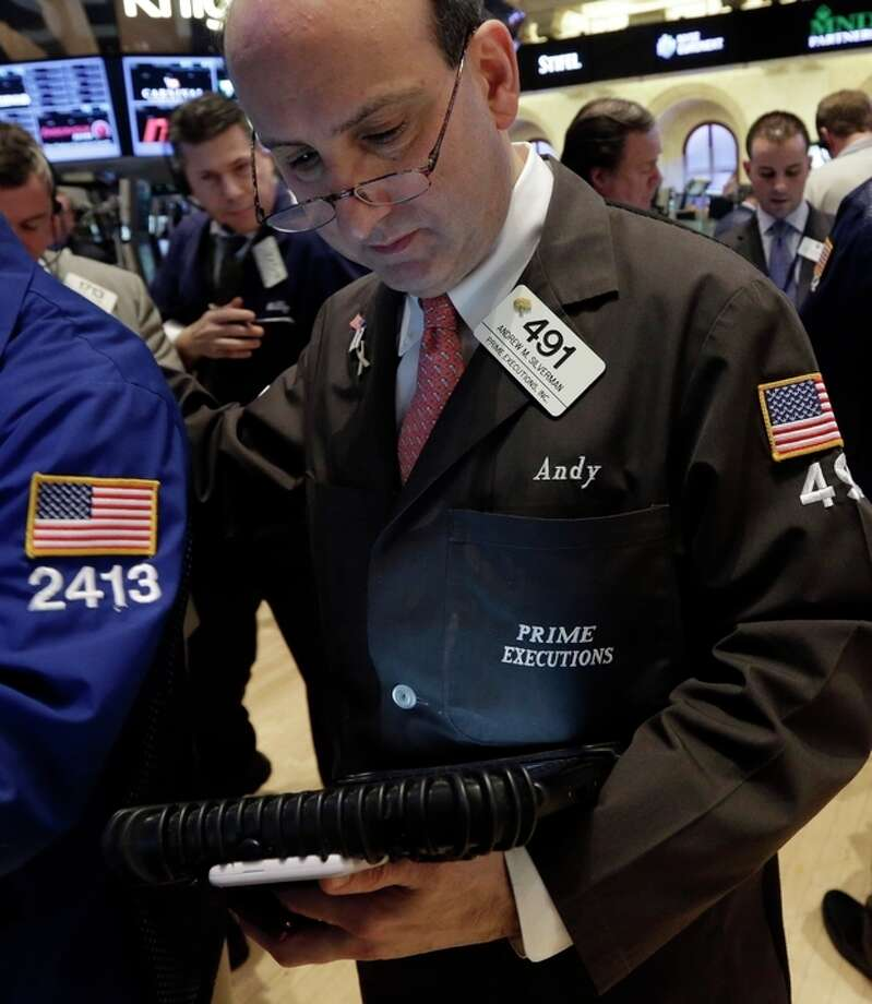 Trader Andrew Silverman, right, works on the floor of the New York Stock Exchange Friday, March 8, 2013. Stocks are opening higher on Wall Street after the government reported a burst of hiring last month that sent the unemployment rate to a four-year low. (AP Photo/Richard Drew) / AP