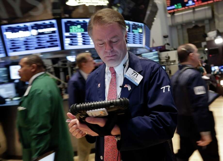 Trader F. Hill Creekmore works on the floor of the New York Stock Exchange Friday, March 8, 2013. Stocks are opening higher on Wall Street after the government reported a burst of hiring last month that sent the unemployment rate to a four-year low. (AP Photo/Richard Drew) / AP