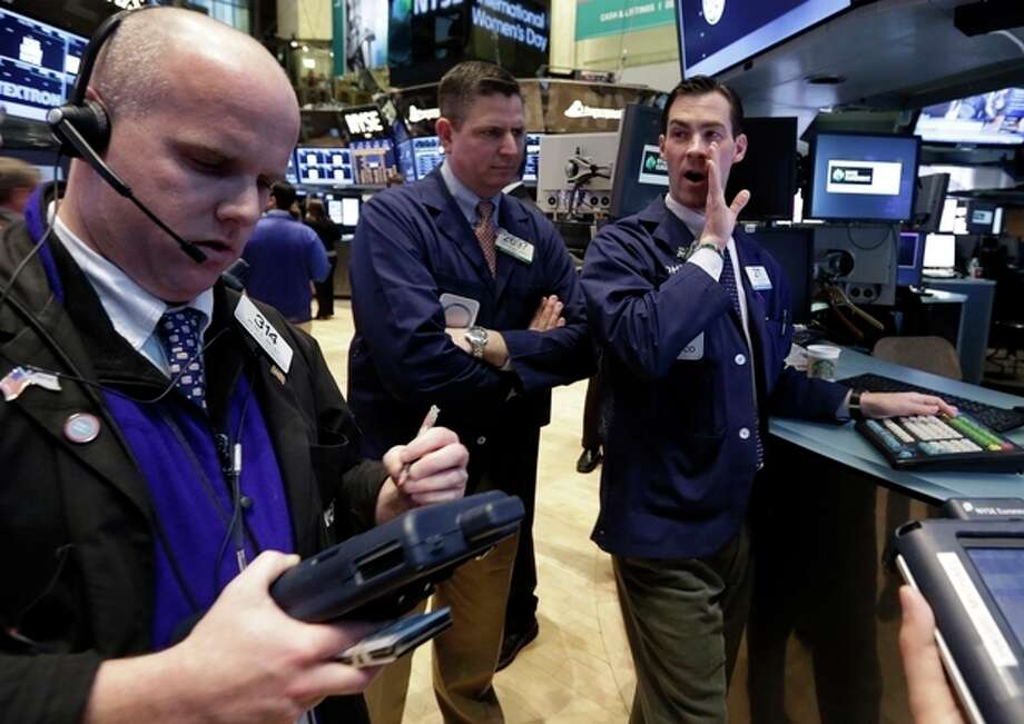 Specialist John McNierney, right, works on the floor of the New York Stock Exchange Friday, March 8, 2013. Stocks are opening higher on Wall Street after the government reported a burst of hiring last month that sent the unemployment rate to a four-year low. (AP Photo/Richard Drew) / AP