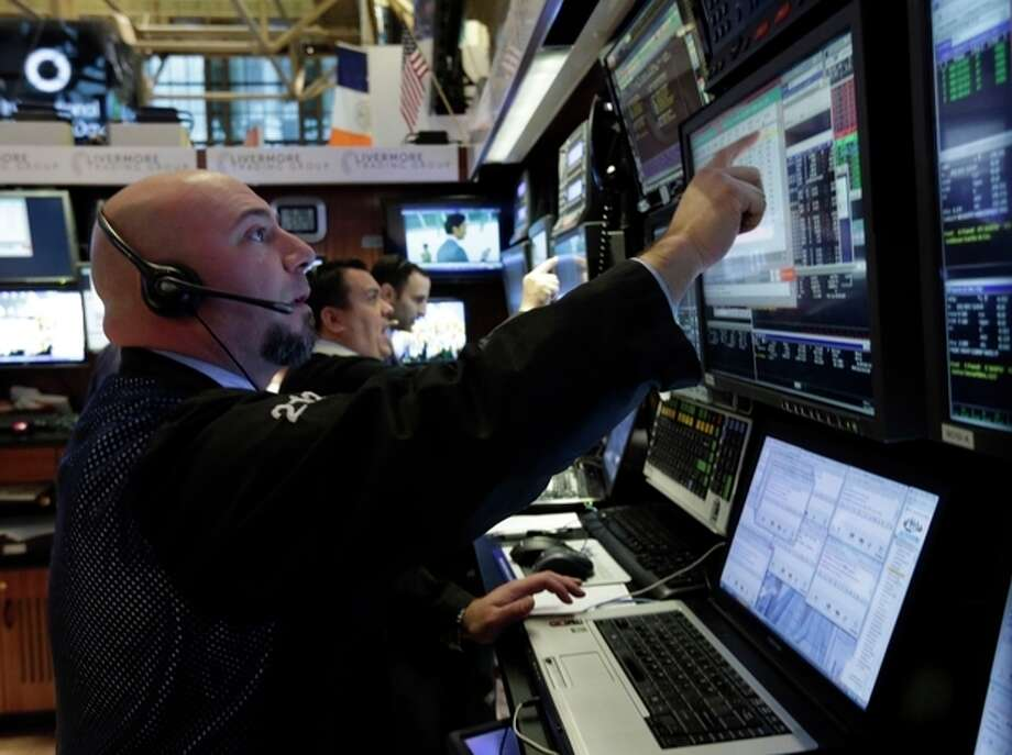 Traders work in their booth on the floor of the New York Stock Exchange Friday, March 8, 2013. Stocks are opening higher on Wall Street after the government reported a burst of hiring last month that sent the unemployment rate to a four-year low. (AP Photo/Richard Drew) / AP