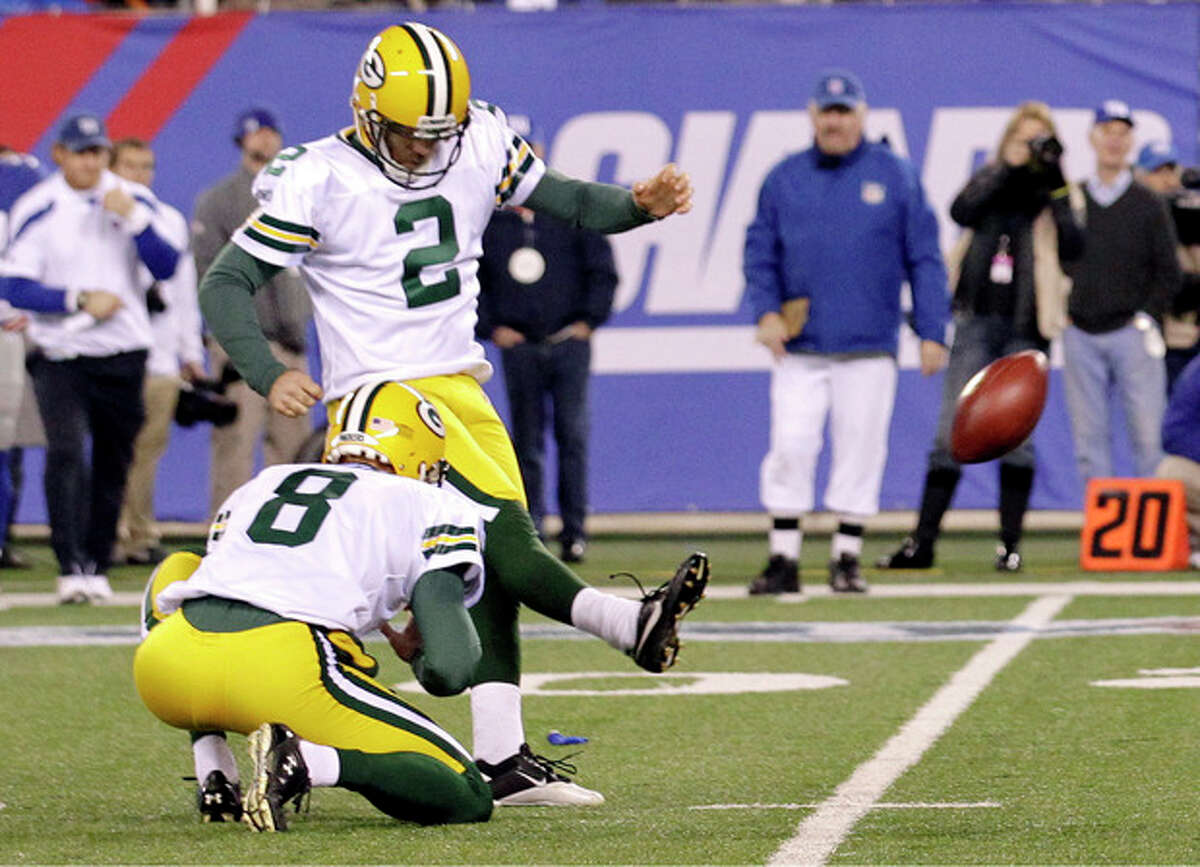 Green Bay Packers' Mason Crosby (2) kicks a field goal at the end of the fourth quarter of an NFL football game against the New York Giants on Sunday, Dec. 4, 2011, in East Rutherford, N.J. The Packers won 38-35. (AP Photo/Julio Cortez)