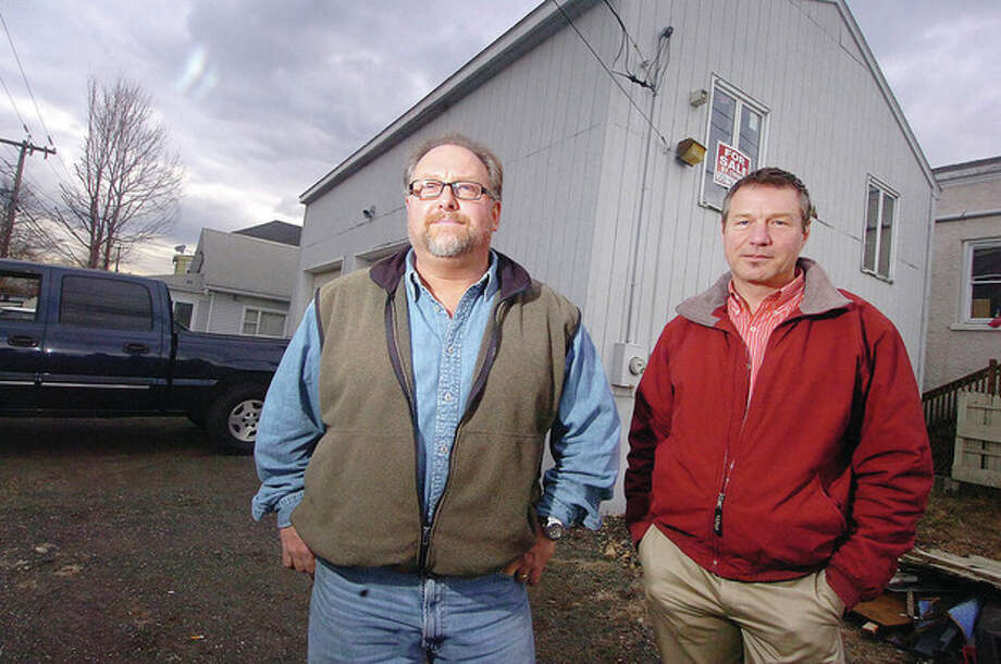 Hour Photo/ Alex von Kleydorff. L-R Owner of Minuteman Land Services Jordan Grant and 2 Sniffen St. property owner Ron Czebiniak / 2013 The Hour Newspapers