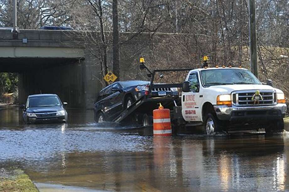 Flooding from Sunday''s storm causing cars to be stuck along Keeler Avenue in Norwalk on Monday. hour photo/matthew vinci