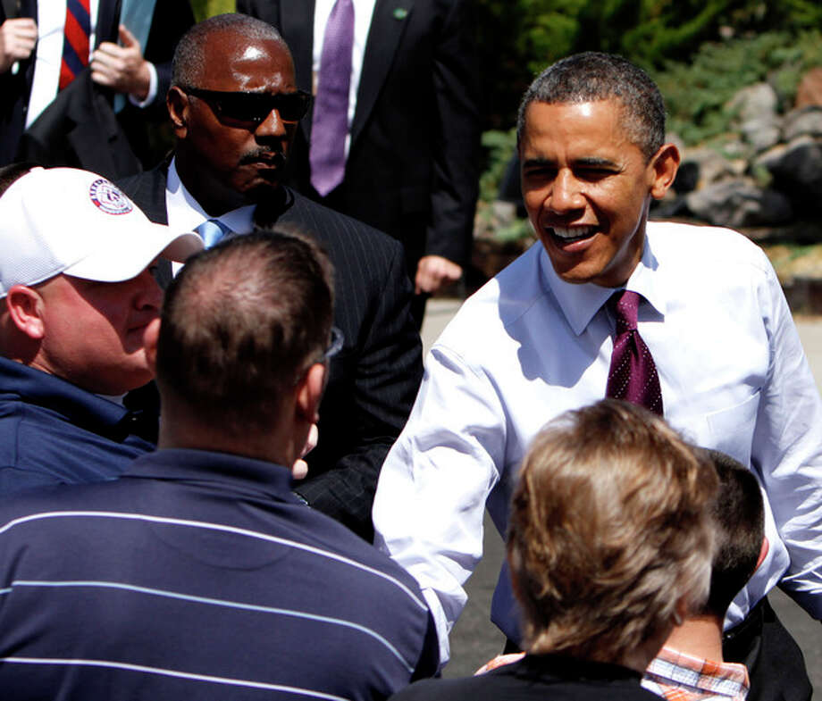 President Barack Obama visits with the crowd during his visit to the home of Val and Paul Keller, in Reno, Nev., Friday, May 11, 2012. Obama met with the Kellers who recently refinanced their home loan under a federally backed program that the President wants to expand to all homeowners who are paying their mortgages on time.(AP Photo/Rich Pedroncelli) / AP