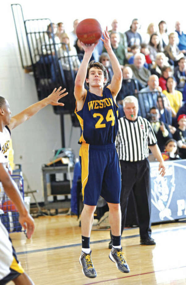 Hour photo/Danielle RobinsonWeston's Charlie DiPasquale lifts off for a shot during Saturday's Class M state tournament quarterfinal game against Kaynor Tech in Waterbury. DiPasquale had a game-high 28 points -- including several key baskets -- as the 23rd-seeded Trojans knocked out No. 2 Kaynor, 62-54.