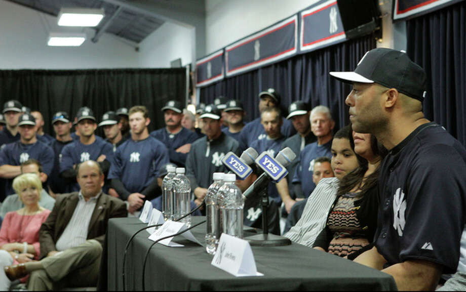 Yankees front office, coaches and teammates listen as New York Yankees pitcher Mariano Rivera, far right, who holds baseball's all-time saves record, announces his plans to retire at the end of the 2013 season during a news conference at Steinbrenner Field Saturday, March 9, 2013 in Tampa, Fla. (AP Photo/Kathy Willens) / AP