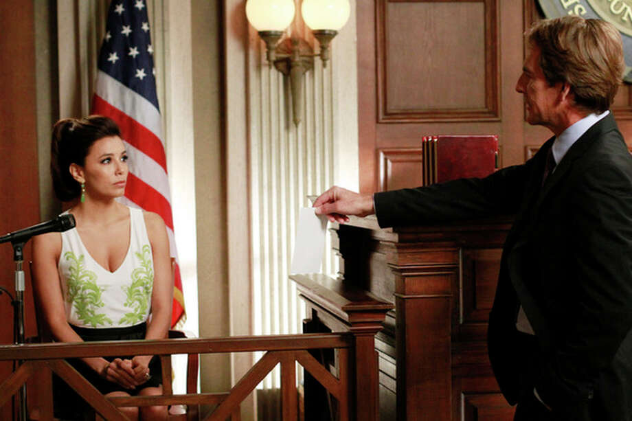 """In this publicity image released by ABC, Eva Longoria, left, and Scott Bakula are shown in a scene from the series finale of """"Desperate Housewives,"""" that was aired Sunday, May 13, 2012 at 9:00p.m. EST on ABC. (AP Photo/ABC, Ron Tom) / © 2012 American Broadcasting Companies, Inc. All rights reserved."""