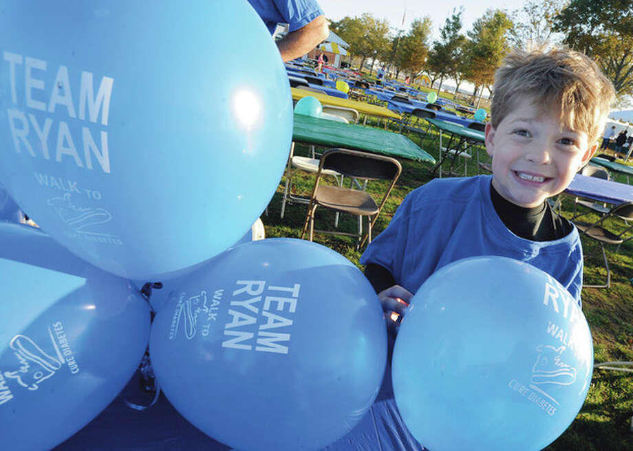 hour photo/Matthew Vinci Kevin Divico 8, with Team Ryan who has type 1 diabetes is among the many to attend the annual fall Walk to Cure Diabetes Sunday at Calf Pasture Beach. / (C)2011, The Hour Newspapers, all rights reserved