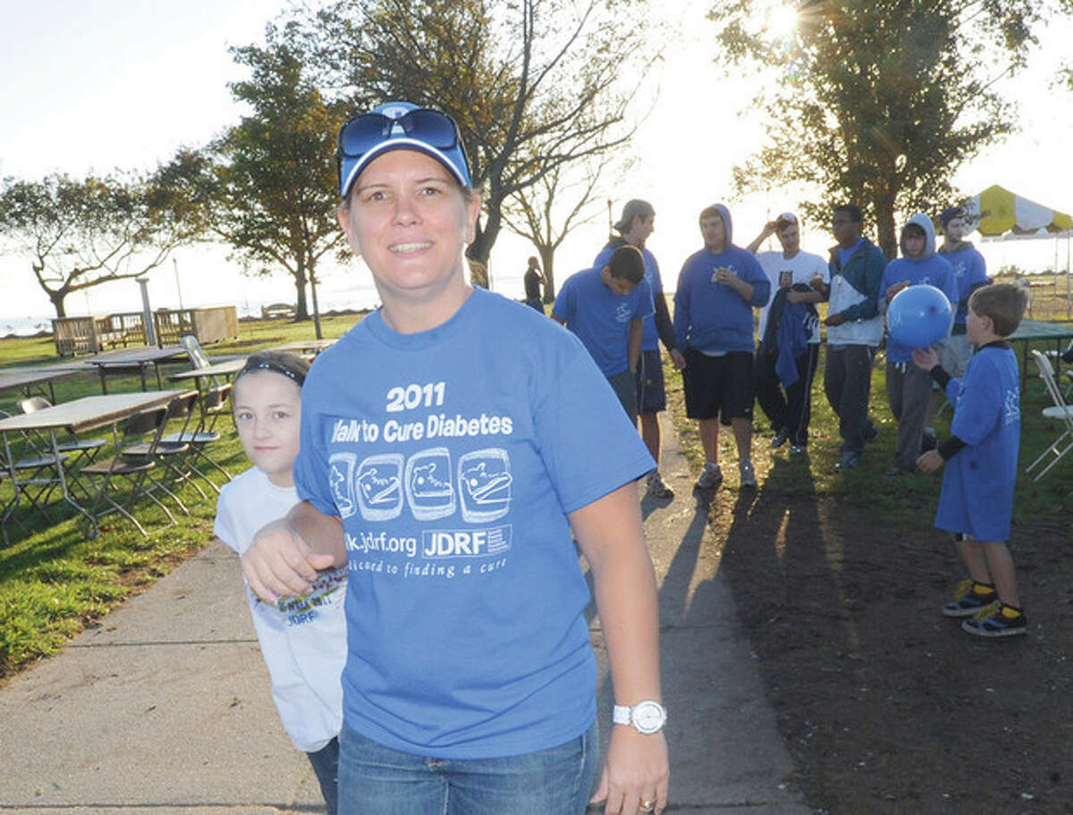 Gina Guerrerd and her 11 year old daughter Sophia who has type 1 diabetes participates in the juvenile diabetes research foundation's Walk to Cure Diabetes at Calf Pasture Beach on Sunday. hour photo/Matthew Vinci