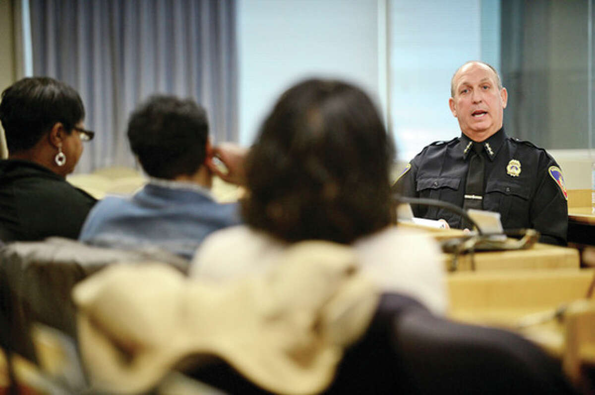 """Hour photo / Erik Trautmann Stamford's new Chief of Police Jonathan Fontneau speaks to residents of the downtown and West Side at the """"Meet the Chief"""" public forum Saturday at the Government Center."""