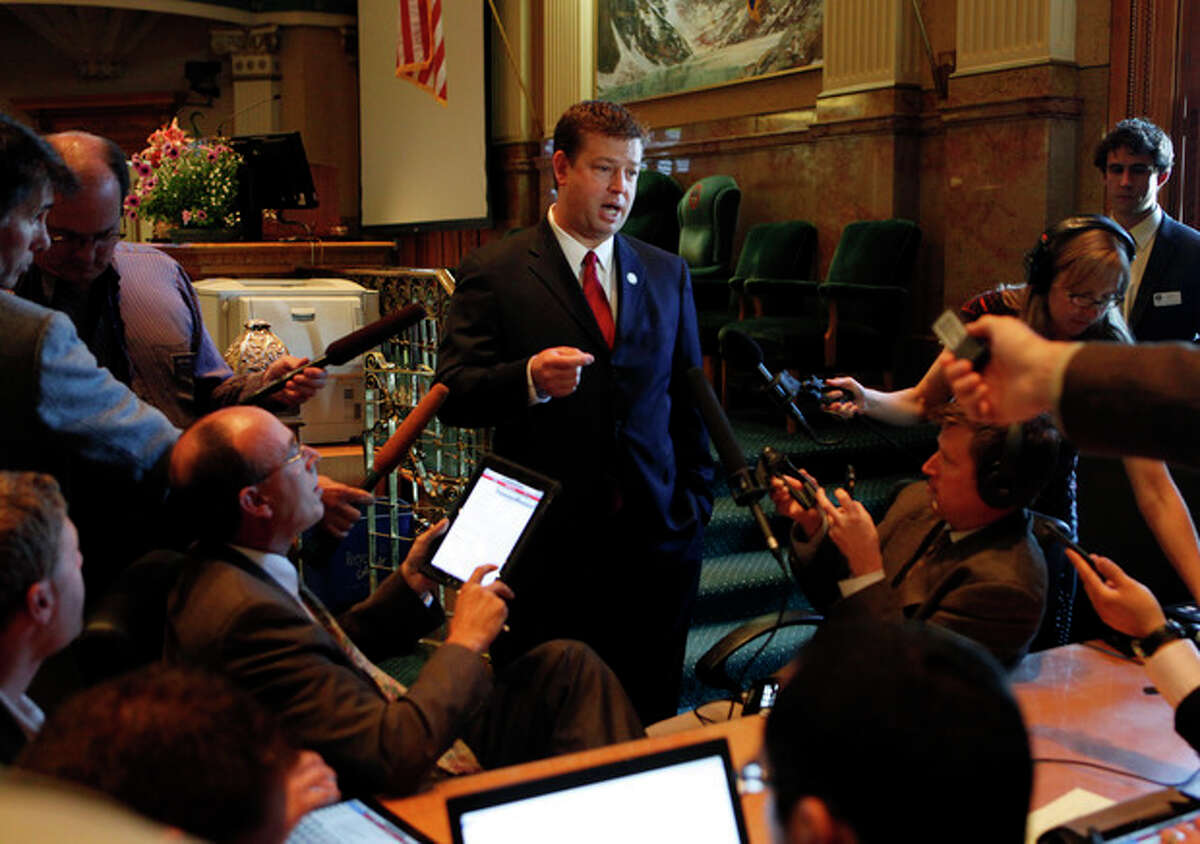 House Speaker Frank McNulty, right, R-Highlands Ranch, talks to journalist during a break in the special session at the Capitol in Denver on May 14, 2012. Gov. John Hickenlooper called the special session for lawmakers to vote on Civil Unions and other issues not completed when last weeks general session ended. (AP Photo/Ed Andrieski)
