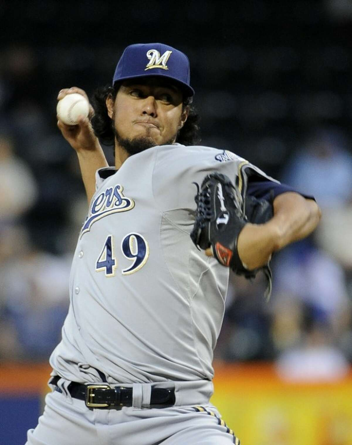 Milwaukee Brewers starting pitcher Yovani Gallardo throws against the New York Mets in the first inning of a baseball game on Monday, May 14, 2012, at Citi Field in New York. (AP Photo/Kathy Kmonicek)