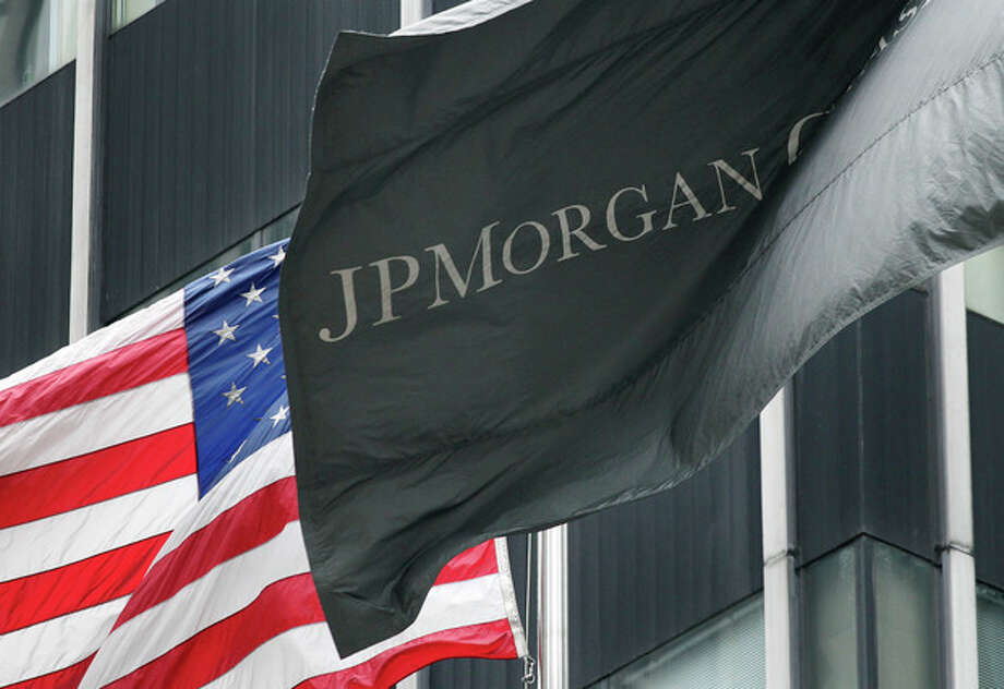 The corporate flag for JPMorgan Chase flies at corporate headquarters, Monday, May 14, 2012 in New York. JPMorgan, the largest bank in the United States, is seeking to minimize the damage caused by a $2 billion trading loss, disclosed Thursday by CEO Jamie Dimon. (AP Photo/Mark Lennihan) / AP
