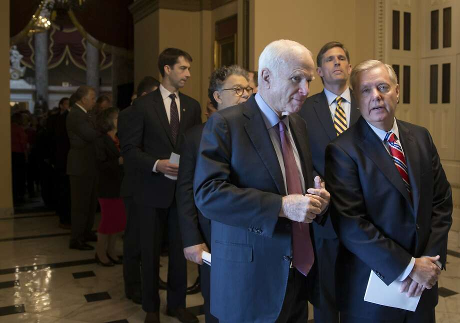 Senate Armed Services Committee chairman Sen. John McCain, R-Ariz., confers with Sen. Lindsey Graham, R-S.C., right, a member of the panel, as they join other senators on Capitol Hill in Washington, Wednesday, June 8, 2016, walking to attend an address to Congress by India's Prime Minister Narendra Modi. The Senate is working on a plan by Sen. McCain to increase defense spending by nearly $18 billion to pay for equipment and troops the Pentagon didn't request. Standing at rear between them is Sen. Martin Heinrich, D-N.M. and Sen. Al Franken, D-Minn. (AP Photo/J. Scott Applewhite) Photo: J. Scott Applewhite, Associated Press