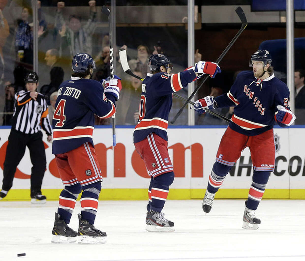 New York Rangers' Rick Nash, right, celebrates his goal with teammates during the third period of the NHL hockey game against the Buffalo Sabres in New York, Sunday, March 3, 2013. The Rangers beat the Sabres in a shoot-out, 3-2. (AP Photo/Seth Wenig)