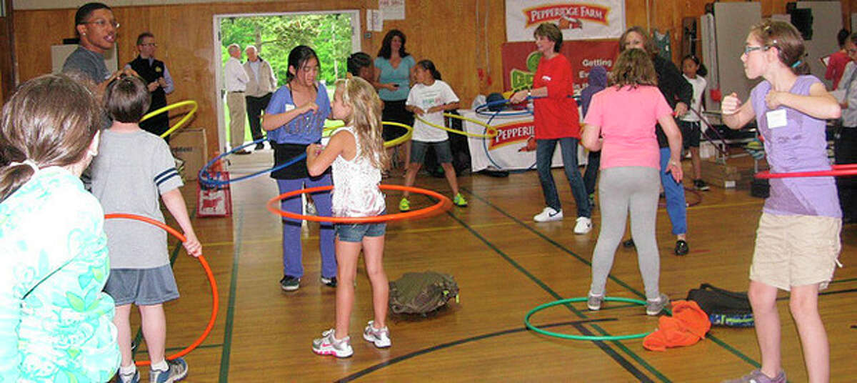 Photo by Business Wire Fit Kids participants enjoy their new sports equipment donated by Pepperidge Farm and Good Sports during their Field Day celebration on Monday.
