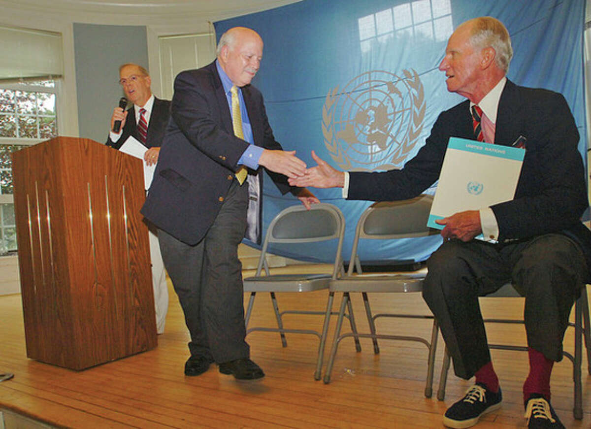 Hour photo / Erik Trautmann Westport First selectman Gordon Joseloff welcomes Ambassador Joseph Verner Reed, the Under Secretary General and Special Adviser to the Secretary General of the U.N., during the opening ceremonies of the 46th annual jUNe Day event while organizer Bill Hass addresses the crowd at Saugatuck School in Westport Saturday.