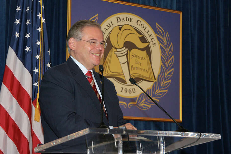 """In this Jan. 31, 2010, image released by Miami Dade College, shows Sen. Robert Menendez, D-N.J., speaks at the signing of his book """"Growing American Roots"""" at the college in Miami. Menendez sponsored legislation with incentives for natural gas vehicles conversions that would benefit the biggest political donor to his re-election, Dr. Salomon Melgen, the same eye doctor whose private jet Menendez used for two personal trips to the Dominican Republic, an Associated Press investigation found. (AP Photo/Miami Dade College, Phil Roche) / Miami Dade College"""