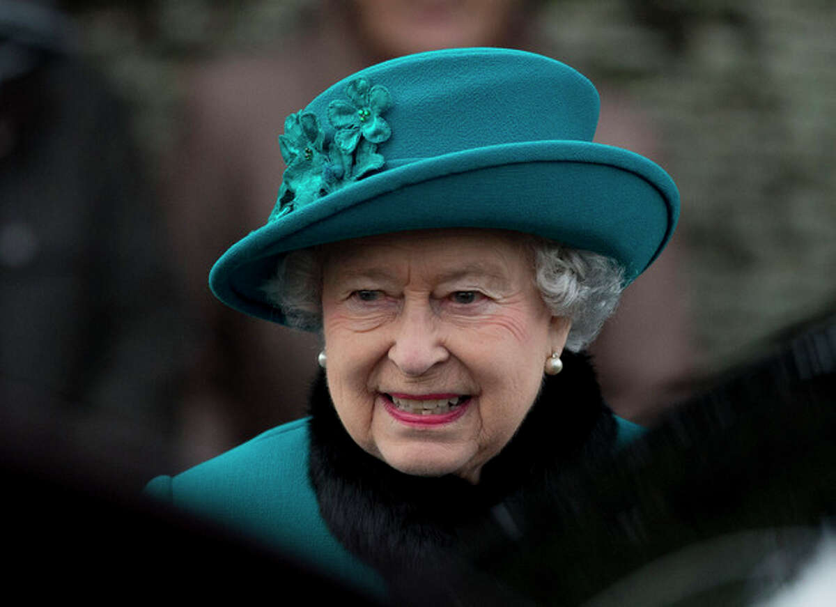 FILE - A Tuesday, Dec. 25, 2012 photo from files showing Britain's Queen Elizabeth II as she walks to get in her car after attending the British royal family's traditional Christmas Day church service in Sandringham, England. Queen Elizabeth has been taken to the King Edward VII hospital in central London suffering from gastroenteritis, Sunday, March 3, 2013. A palace spokesman said she was expected to stay in hospital for two days and all engagements for this week will be either postponed or cancelled. (AP Photo/Matt Dunham, File)