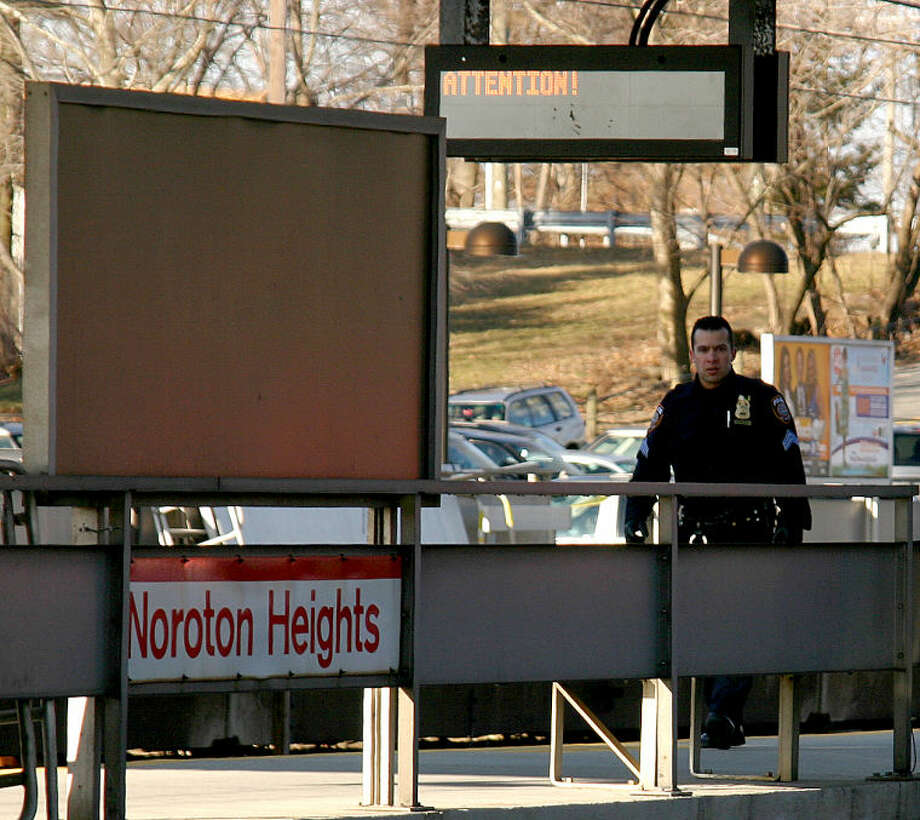 Photo by Chris Bosak Darien and MTA police respond to the Noroton Heights train station on Monday morning. A pedestrian was hit by a train at the station.