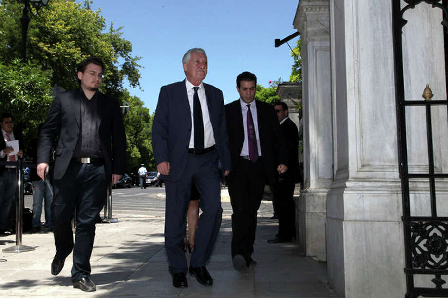Greek leader of the Left Democratic party (DIMAR) Fotis Kouvelis, second left, arrives at the presidential palace for a meeting with President Karolos Papoulias in Athens, on Tuesday, May 15, 2012. Greece' president is to meet the leaders of five political parties, broadening talks to try and form a coalition government and end a nine-day deadlock in the crisis-hit country. (AP Photo/Petros Giannakouris) / AP