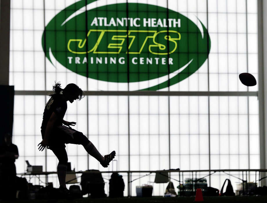 Lauren Silberman boots the ball during kicker tryouts at an NFL football regional combine workout, Sunday, March 3, 2013, at the New York Jets' training facility in Florham Park, N.J. (AP Photo/Mel Evans) / AP
