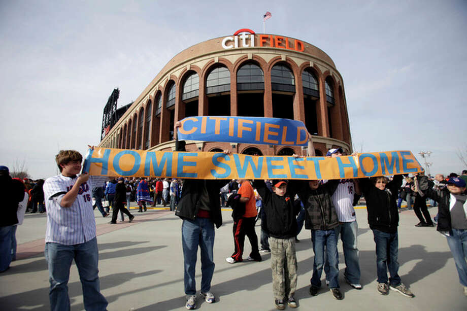 FILE - In this April 13, 2009, file photo, baseball fans hold up a sign in front of the Citi Field before the New York Mets' home-opening baseball game against the San Diego Padres at Citi Field in New York. A person familiar with the announcement says Major League Baseball will announce Wednesday, May 16, 2012, that the Mets will host the 2013 All-Star game at Citi Field. The person spoke on condition of anonymity on Tuesday, May 15, because MLB did not reveal the purpose of Wednesday's news conference at City Hall in New York. (AP Photo/Seth Wenig, File) / AP2009