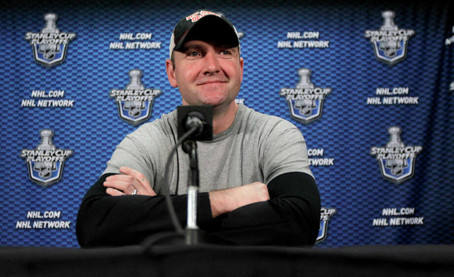 New Jersey Devils head coach Peter DeBoer talks to the media during a news conference, Tuesday, May 15, 2012, in Newark, N.J. A day earlier, the Devils lost 3-0 to the New York Rangers in Game 1 of the NHL hockey Stanley Cup Eastern Conference final playoff series. Game 2 is Wednesday in New York. (AP Photo/Julio Cortez) / AP