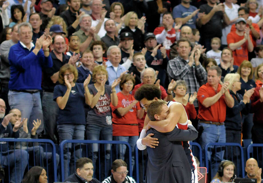 Gonzaga's Elias Harris and coach Mark Few hug as Harris exited the court in his last home game appearance in the second half of an NCAA college basketball game against Portland, Saturday, March 2, 2013, in Spokane, Wash. Gonzaga defeated Portland 81-52. (AP Photo/Jed Conklin) / FR170252 AP
