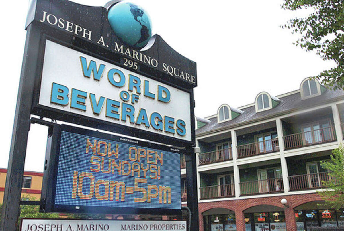 World of Beverages will be open for Sunday liquors sales when the new law goes into effect later this month. Hour photo / Erik Trautmann