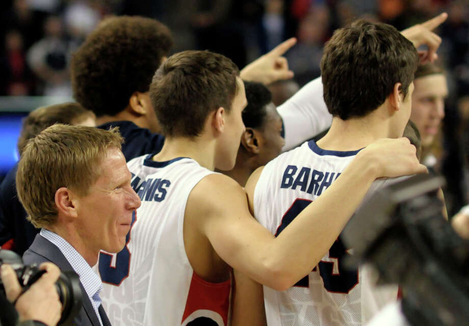 Gonzaga's coach Mark Few, left, celebrates with his team after their West Coast Conference Championship win in an NCAA college basketball game against Portland, Saturday, March 2, 2013, in Spokane, Wash. Gonzaga defeated Portland 81-52. (AP Photo/Jed Conklin) / FR170252 AP