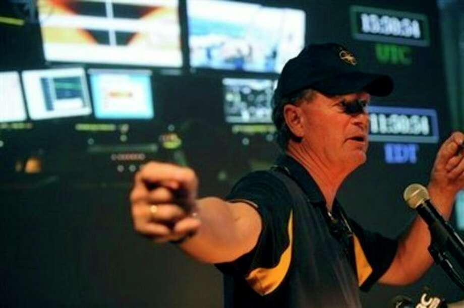 Dr. Robert Ballard, president of the Sea Research Foundation at the Mystic Aquarium Institute for Exploration, announces details about his next expedition at the Nautilus Live Theater at the Mystic Aquarium Institute of Exploration, in Mystic, Conn., Thursday, July 28, 2011. Ballard, best known for discovering the Titanic wreck, has new plans to plumb the depths of the seas. Ballard said Thursday that his latest deep-sea venture will send crews combing through the Black, Aegean and Mediterranean seas for artifacts from ship wrecks and ancient civilizations. (AP Photo/The Day, Tim Martin) MANDATORY CREDIT / AP2011