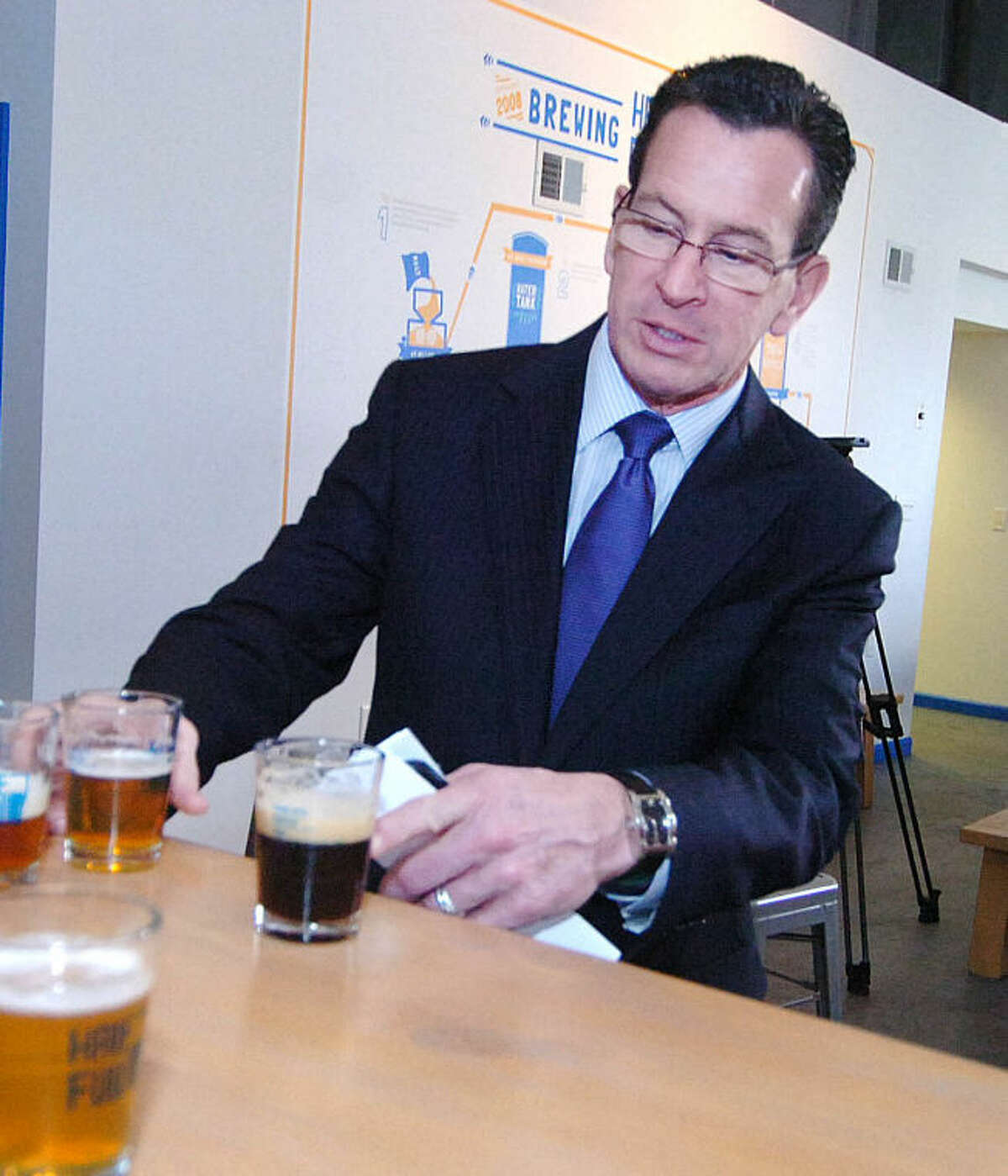 Hour Photo/ Alex von Kleydorff. Gov Dan Malloy samples a Chocolate Coffee Brown Ale and and a Bright Ale at Half Full Brewery