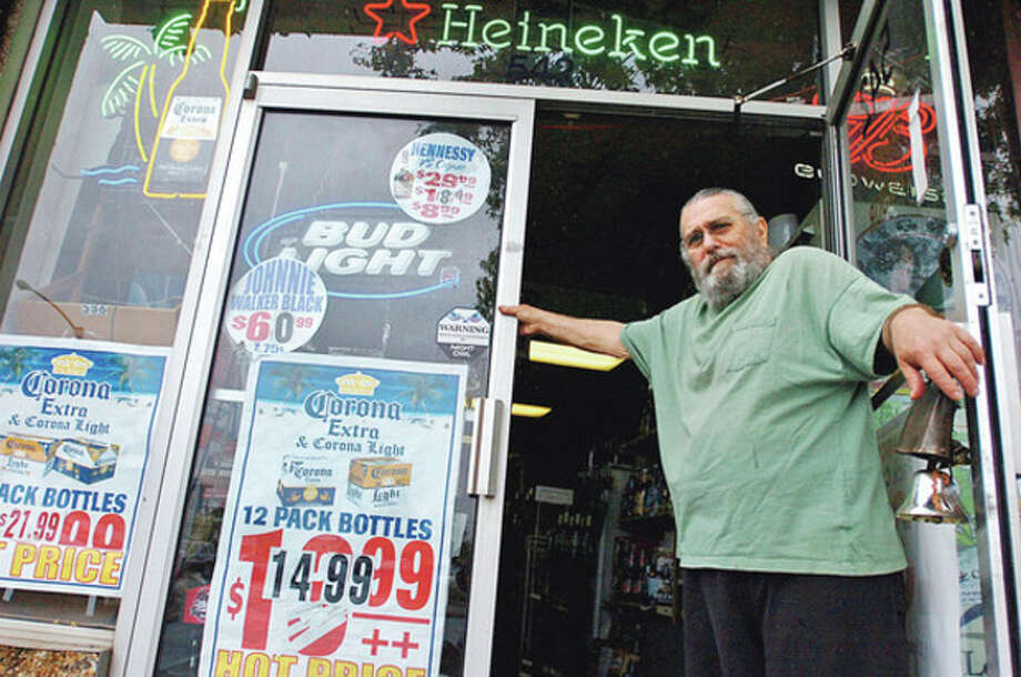 Leslie Bierman, owner of Budget Liquors on West Ave will not be open for Sunday liquors sales when they go into effect later this month.Hour photo / Erik Trautmann / (C)2011, The Hour Newspapers, all rights reserved