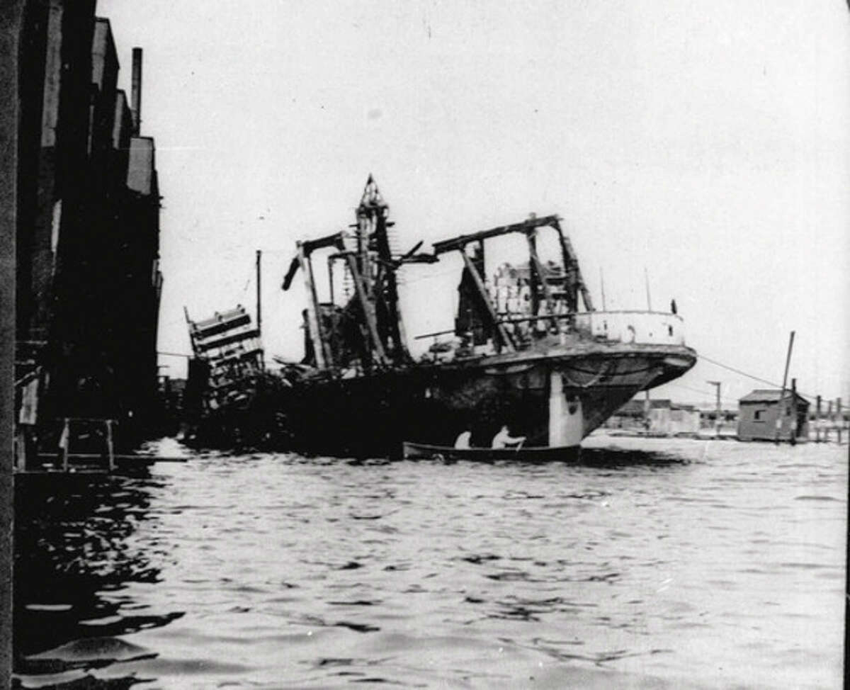 FILE - In this undated file photo, the excursion boat General Slocum lies beached off Hell Gate in New York City's East River, following a fire and resulting panic. The disaster cost the lives of 1,030 mostly German immigrants on June 15, 1904. Ten years after the 9/11 attacks, New York's prevailing mood is to resist the city's natural tides of forgetting, of moving on. (AP Photo)