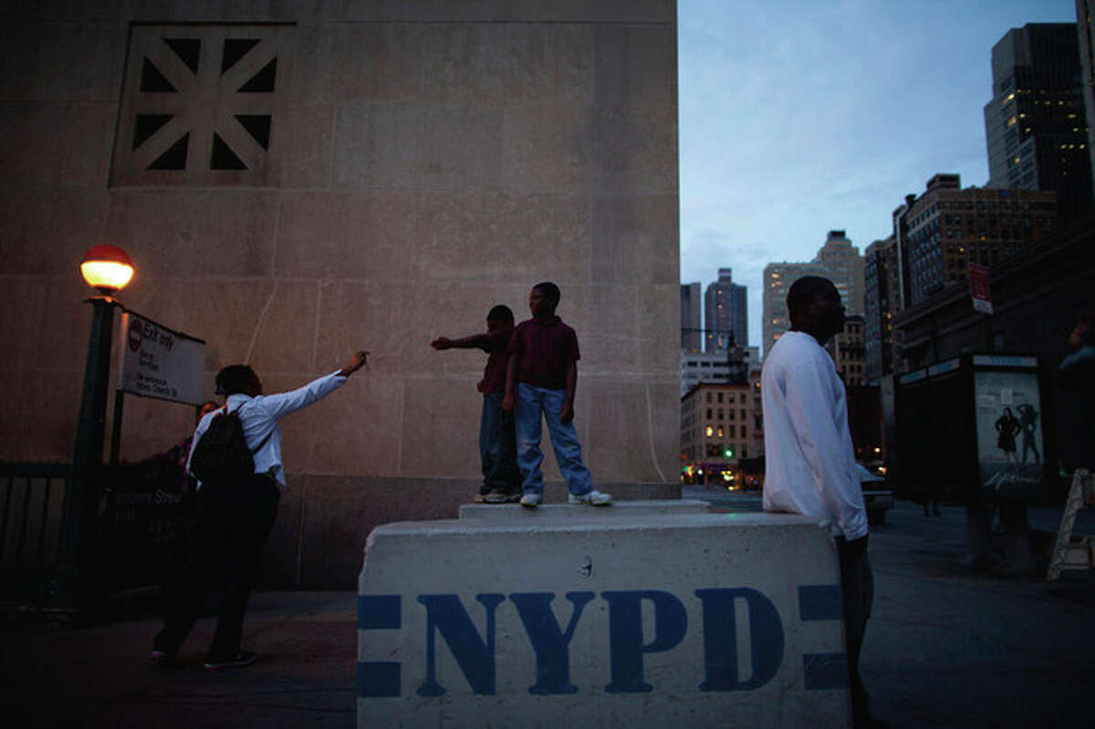Tourists take their pictures near the ground zero construction site in New York, Monday, Sept. 5, 2011. Sept. 11, 2011 will mark the tenth anniversary of the terrorist attacks in the United States.(AP Photo/Oded Balilty)