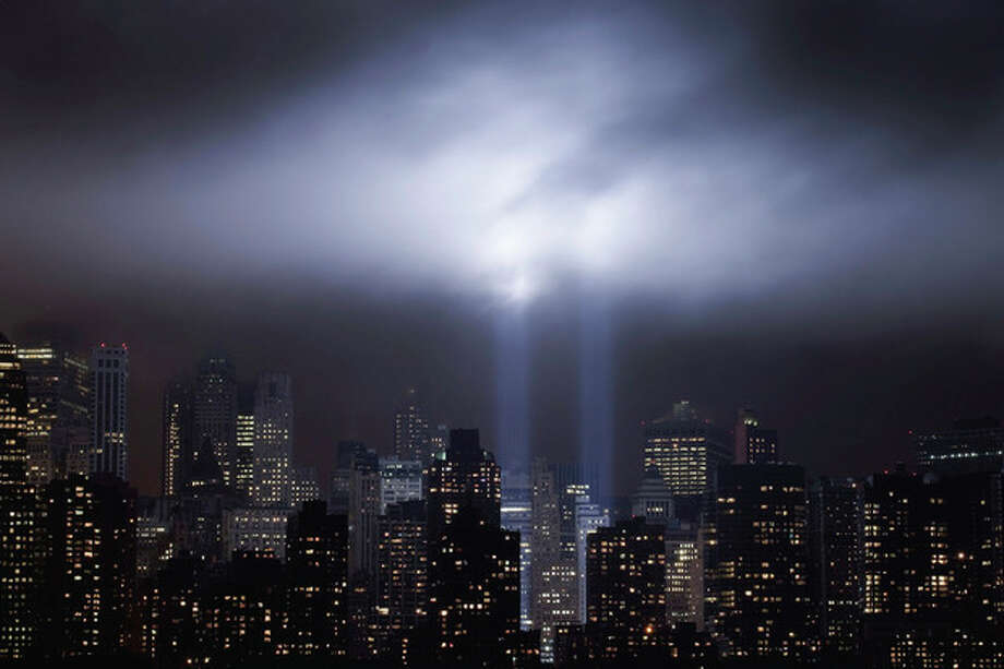 A test of the Tribute in Light rises above lower Manhattan, Tuesday, Sept. 6, 2011 in New York. The memorial, sponsored by the Municipal Art Society, will light the sky on the evening of Sept. 11, 2011 in honor of those who died ten years before in the terror attacks on the United States. (AP Photo/Mark Lennihan) / AP