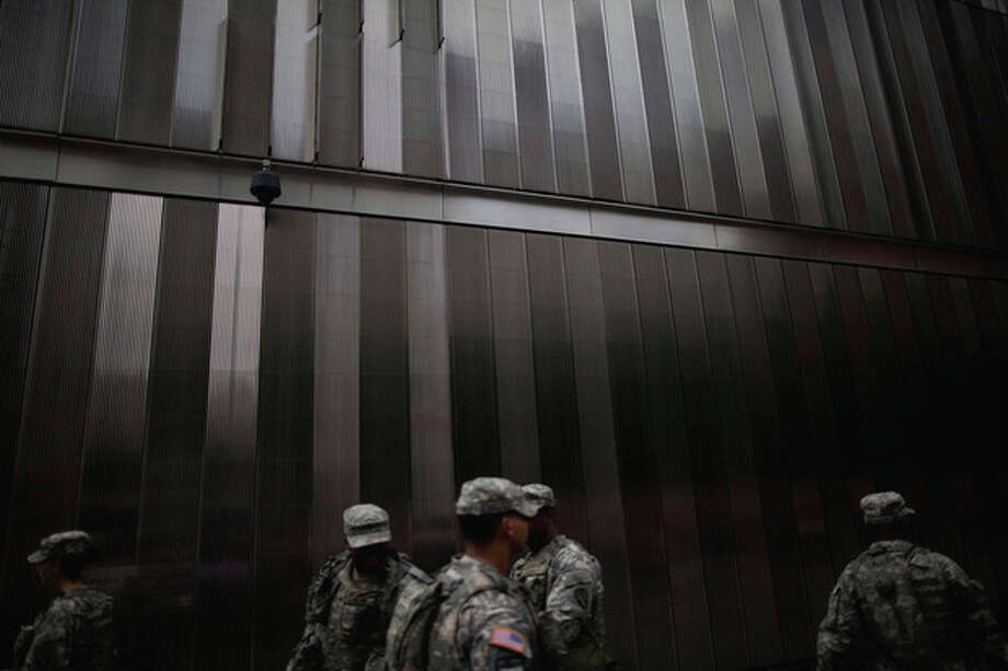 Members of the U.S. National Guard exchange shifts at the ground zero construction site in New York, Monday, Sept. 5, 2011. Sept. 11, 2011 will mark the tenth anniversary of the terrorist attacks in the United States.(AP Photo/Oded Balilty) / AP