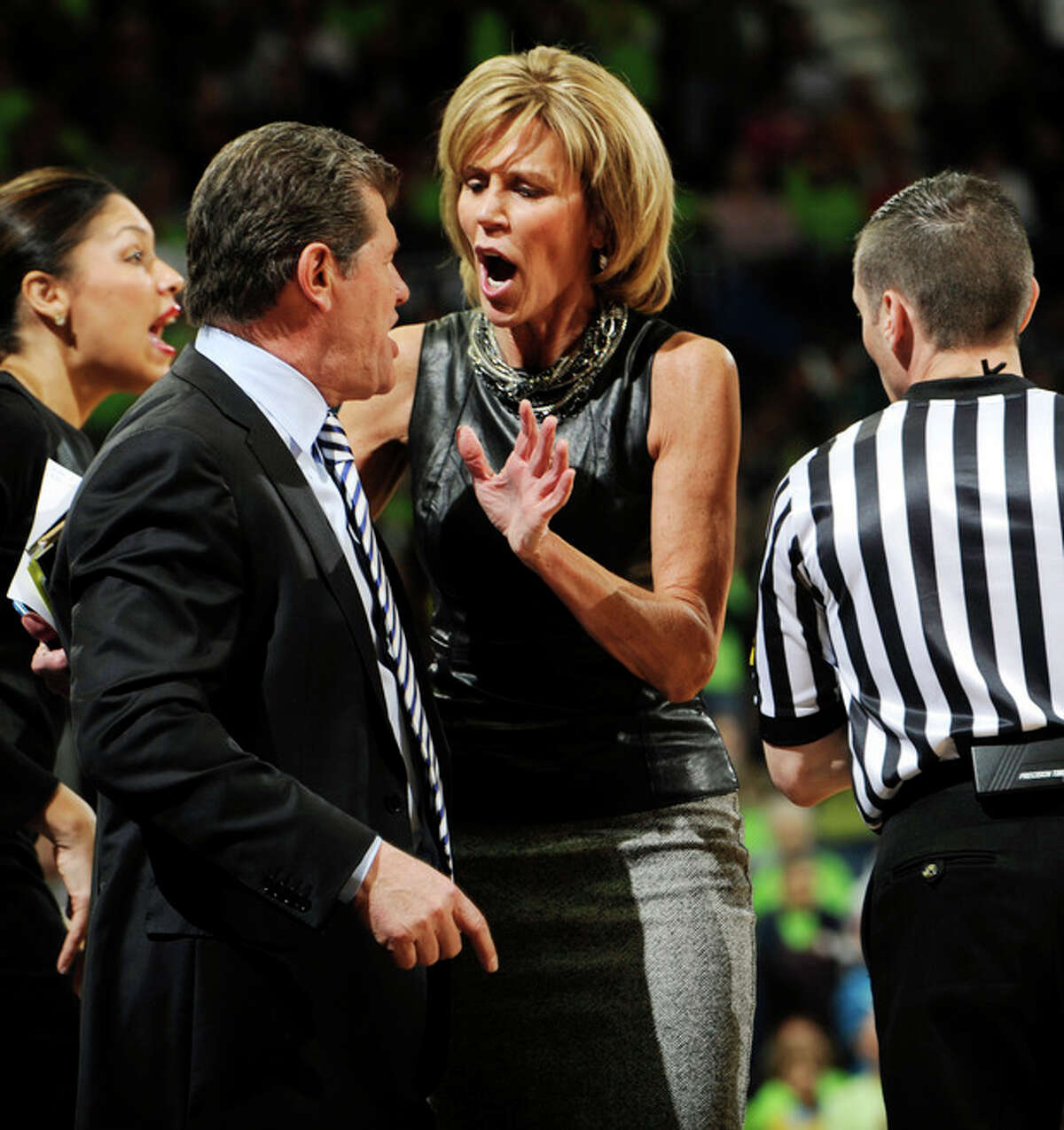 Connecticut associate head coach Chris Dailey, center, tries to calm head coach Geno Auriemma after Auriemma received a technical foul during the first half of an NCAA college basketball game against Notre Dame, Monday, March 4, 2013, in South Bend, Ind. (AP Photo/Joe Raymond)
