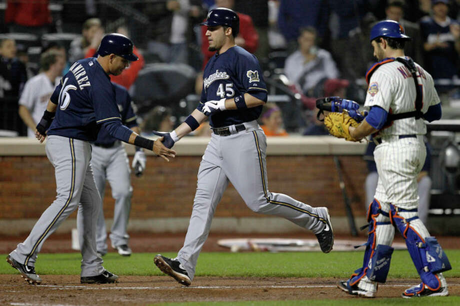 New York Mets catcher Mike Nickeas walks back to the plate as Milwaukee Brewers Aramis Ramirez, left, greets Travis Ishikawa (45) after Ishikawa hit a three-run home run during the sixth inning of their baseball game at Citi Field in New York, Tuesday, May 15, 2012. (AP Photo/Kathy Willens) / AP