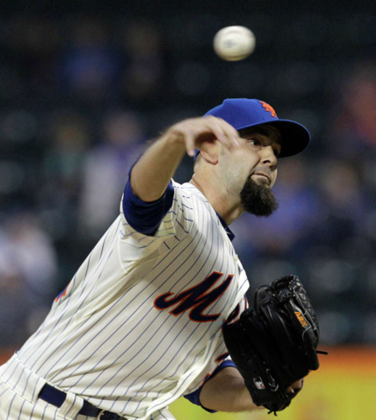 New York Mets starting pitcher Dillon Gee delivers to the Milwaukee Brewers during the first inning of a baseball game at Citi Field in New York, Tuesday, May 15, 2012. (AP Photo/Kathy Willens)