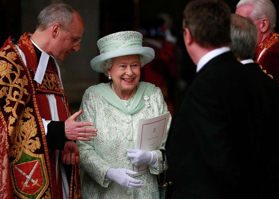 Britain's Queen Elizabeth II departs after a service of thanksgiving with the Dean of St Paul's David Ison, left, at St Paul's Cathedral, London as part of the Diamond Jubilee celebrations Tuesday June 5, 2012. (AP Photo/Tim Hales, Pool) / AP