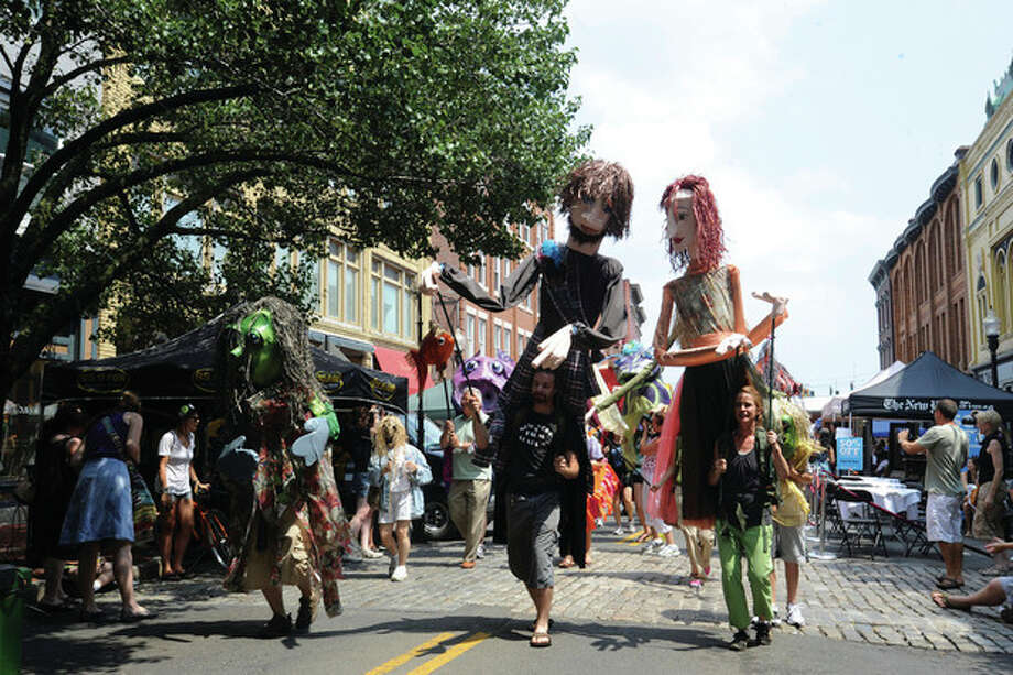 The SONO Arts Festival puppet parade on Washington Street. hour photo/matthew vinci / (C)2011, The Hour Newspapers, all rights reserved